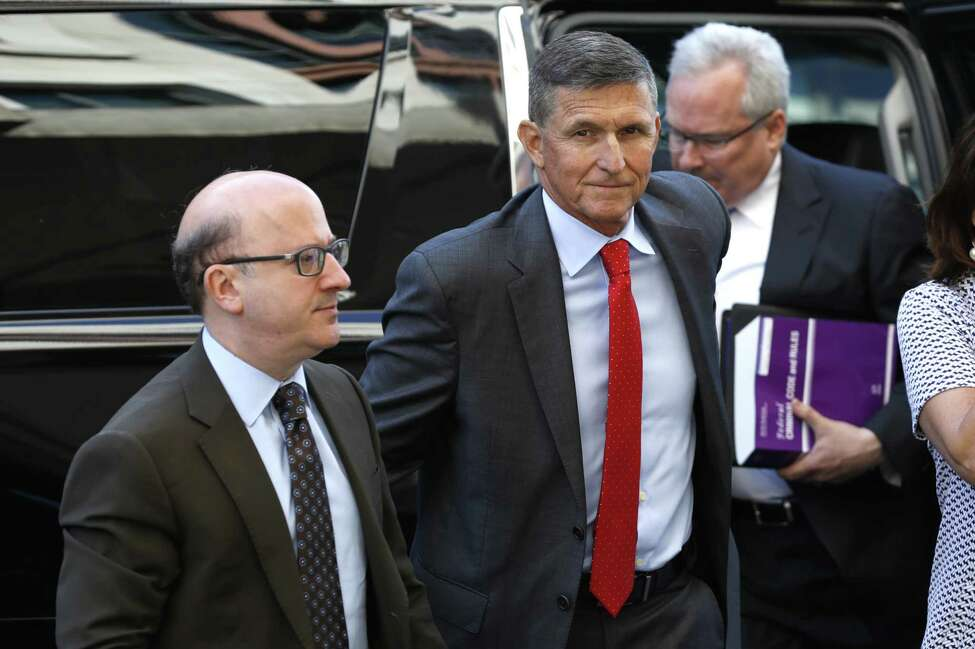 Michael Flynn, former U.S. national security advisor, center, arrives for a status hearing at federal court in Washington, D.C., U.S., on Tuesday, July 10, 2018. FlynnA made his first federal court appearance since pleading guilty last year to lying to federal agents, appearing briefly before a judge who asked to be updated on the status of the case by Aug. 24. Photographer: Yuri Gripas/Bloomberg
