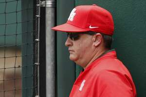 Houston head coach Todd Whitting watches from the dugout during the NCAA baseball game between the Cincinnati Bearcats and the Houston Cougars at Schroeder Park on Saturday, May 20, 2017, in Houston, TX.