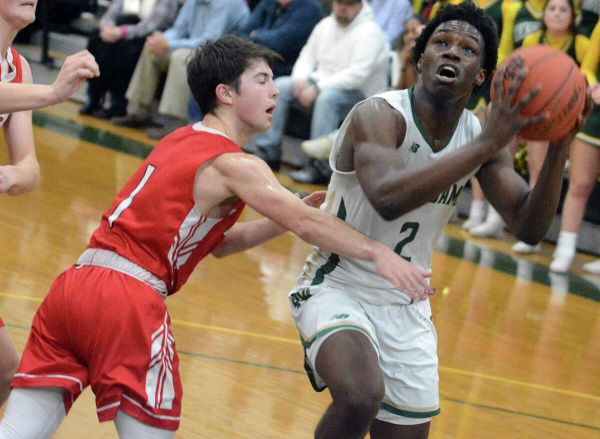 Notre Dame-West Haven's Amadou Kamara (2) is defended by Fairfield Prep's Max Manjos on Friday.