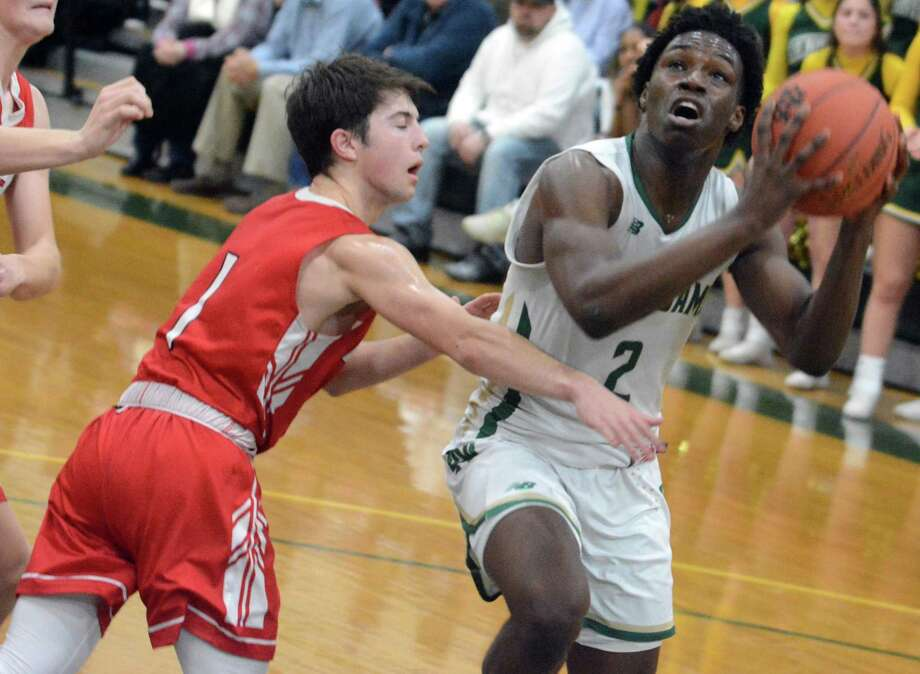 Notre Dame-West Haven's Amadou Kamara (2) is defended by Fairfield Prep's Max Manjos on Friday. Photo: Dave Phillips / For Hearst Connecticut Media / Stamford Advocate Freelance