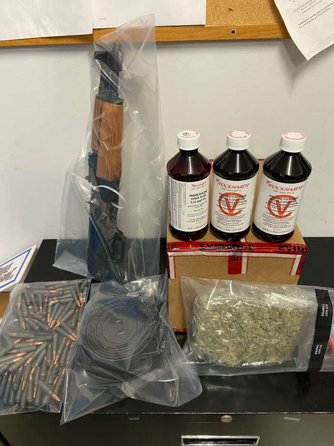A minor car crash yielded the seizure of a loaded AK-47, a 100-round magazine and a large quantity of opioids Friday night, according to the Harris County Sheriff's Office. Photo: Photo Courtesy Harris County Sheriff's Office