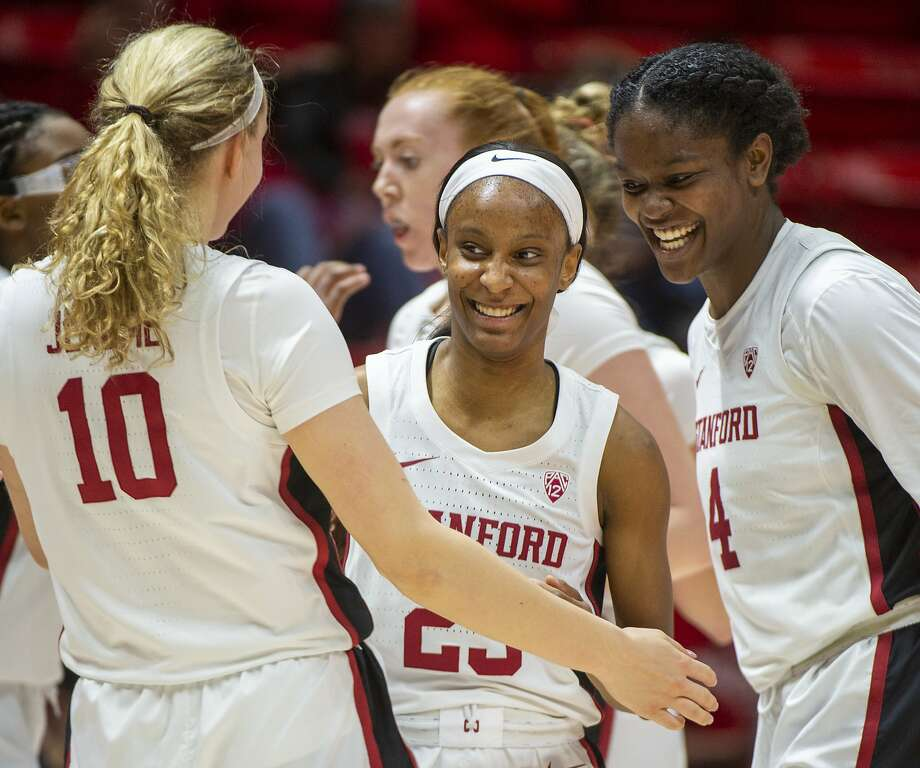 Stanford's Alyssa Jerome (10) and Nadia Fingall (4) congratulate Kiana Williams, who scored to end the first half. Photo: Rick Egan / Associated Press