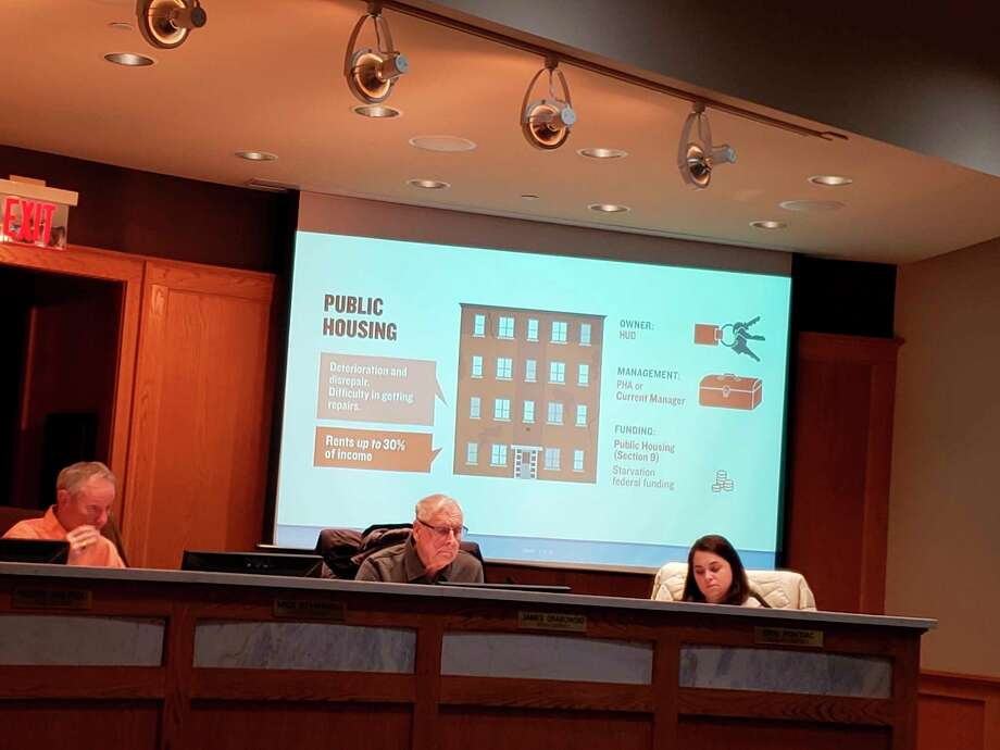 At a recent Manistee City Council work session, councilmembers viewed slides during a presentation on RAD conversion and information on rehabilitation of twoManistee Housing Commission properties.(Arielle Breen/News Advocate)