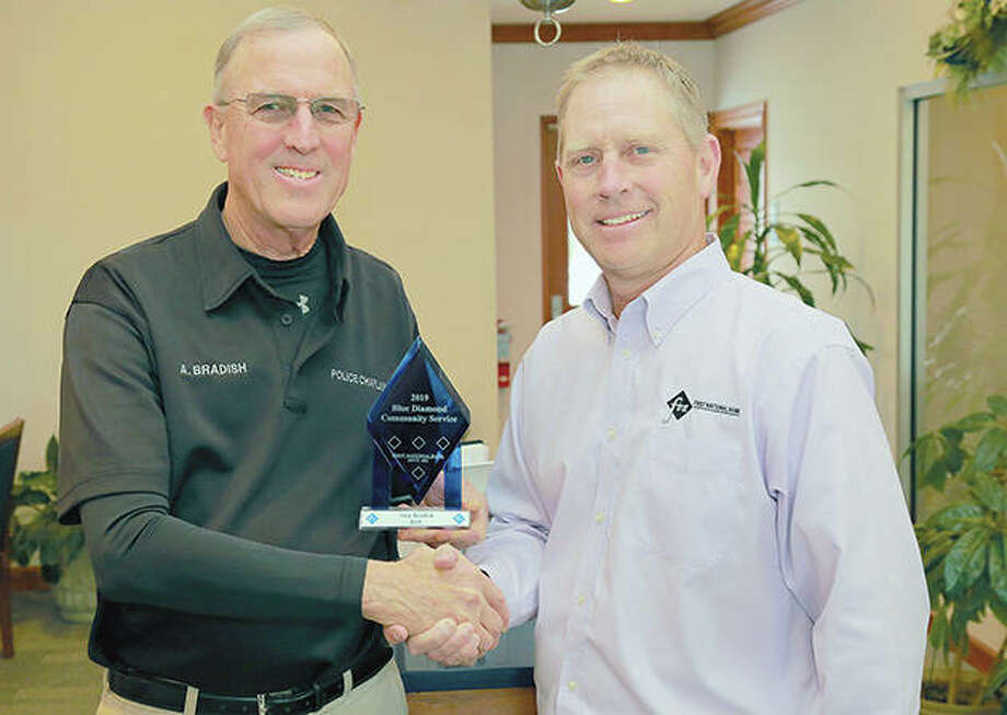 Alan Bradish (left) is presented the Blue Diamond Community Service Award for 2019 by First National Bank President Kai Schnitker. Photo: Photo Provided