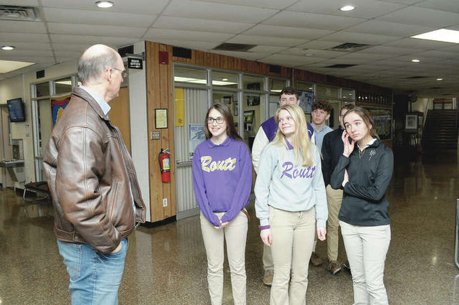 Mike Flynn, chairman of the Jacksonville Tree Project, talks about the program with sophomores from Routt Catholic High School. Photo: Darren Iozia | Journal-Courier