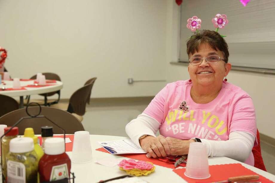 Vivian Kyek of Stamford, a former SPED paraprofessional in Darien, enjoys the Valentine's Day spirit. Photo: Jarrett Liotta /Hearst Connecticut Media /