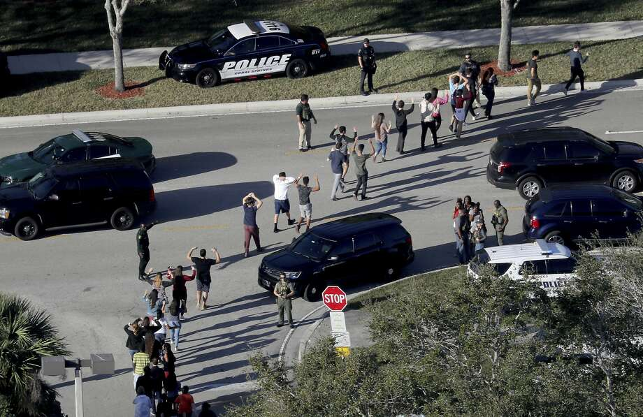 Police evacuate students from Marjory Stoneman Douglas High School in Parkland, Fla., on Feb. 14, 2018. Photo: Mike Stocker / South Florida Sun-Sentinel 2018