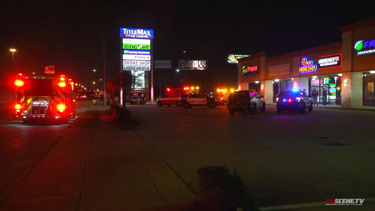 Authorities investigate a shooting that occurred during a robbery in the 11500 block of the Gulf Freeway on Friday, Feb. 14, 2020.