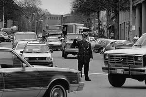 Officer Herb Salamon directs traffic on Greenwich Avenue at Havemeyer Place in March 1987. First Selectman Fred Camillo proposed the elimination of the longtime tradition of traffic cops along Greenwich Avenue, which he estimated as a cost savings of more than $265,000 per year.