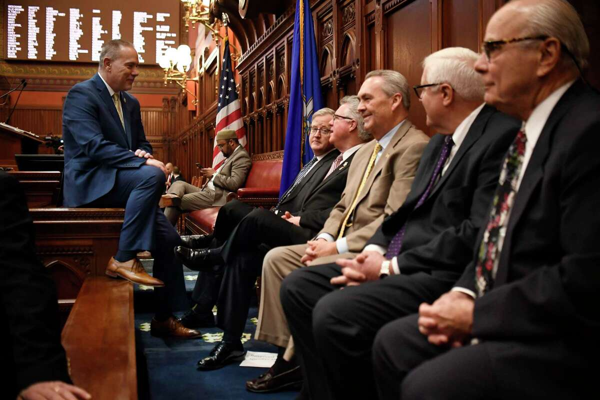 Connecticut Speaker of the House Joe Aresimowicz, D-Berlin, left, speaks with former speakers during opening session at the State Capitol, Wednesday, Feb. 5, 2020, in Hartford, Conn.