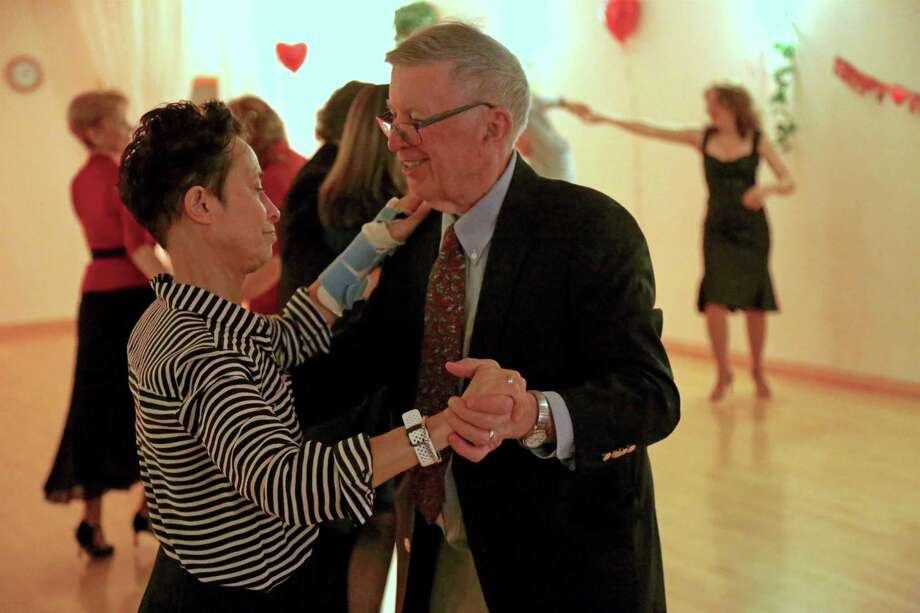 Marisa Manley and Jim Powell of Westport are in step at the Ballroom Elegance Dance Studio's St. Valentine's Day party on Friday, Feb. 14, 2020, in Westport, Conn. Photo: Jarret Liotta / For Hearst Connecticut Media / Jarret Liotta / ©Jarret Liotta 2020