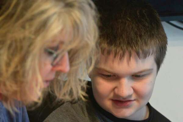 Tammy McInerney and her son Liam hang out in the families kitchen after school. Liam is autistic and has a learning disability. Thursday, February 13, 2020, in New Milford, Conn.