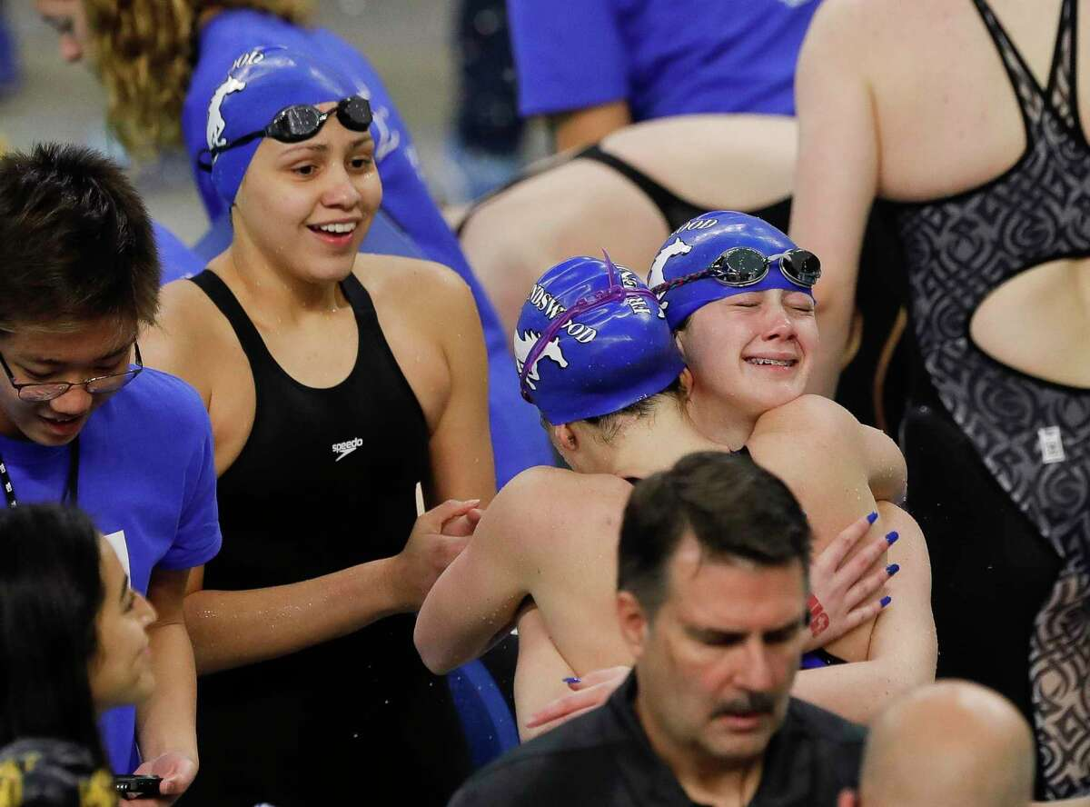 Friendswood swimmers react after winning the Class 5A girls 200-yard medley relay during the UIL State Swimming & Diving Championships at the Lee & Joe Jamail Texas Swimming Center Saturday in Austin. Lady Mustang relay team members include Lesli Sisung, Peyton Becker, Olivia Theall and Abigail Nelson.