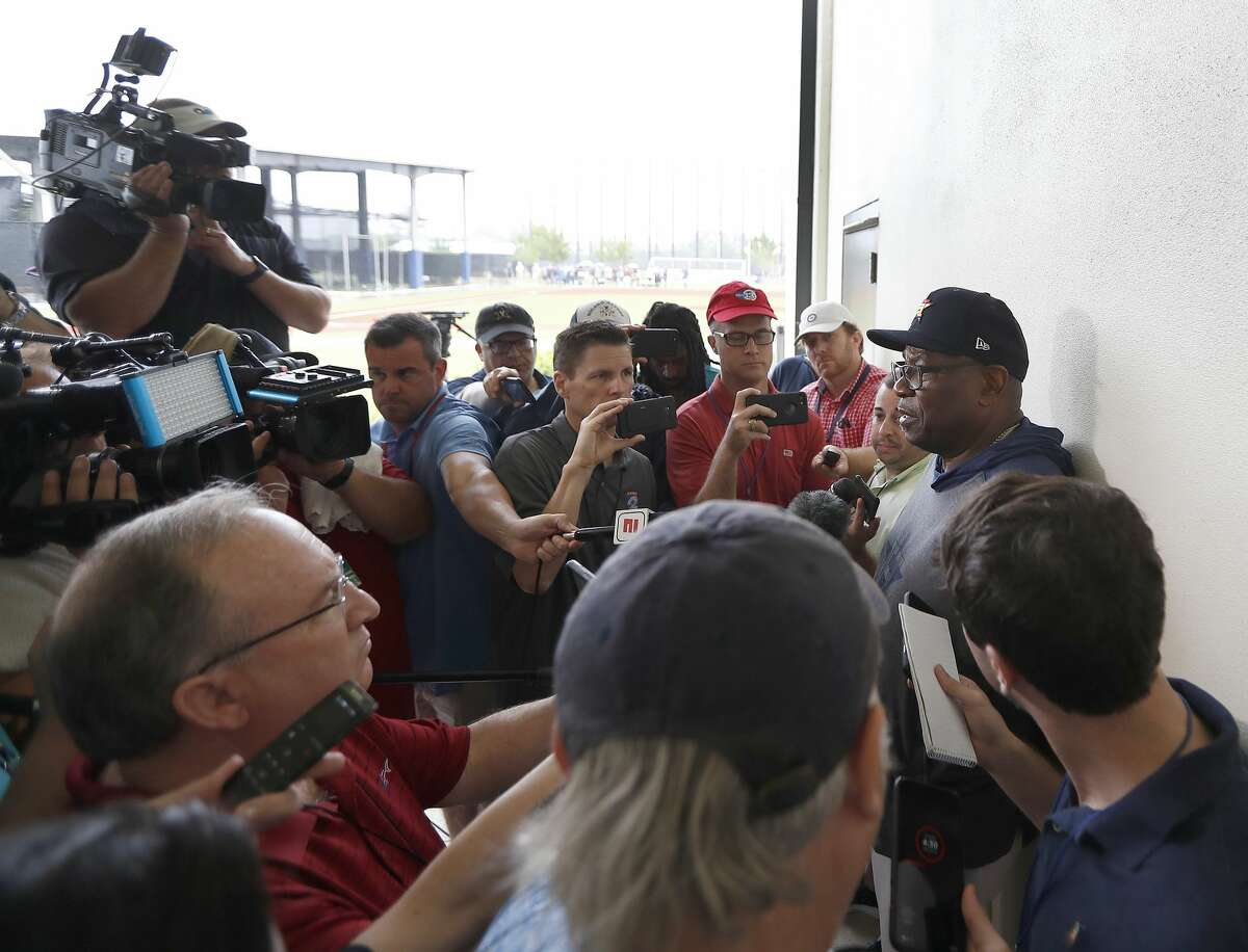 The media surrounding Houston Astros manager Dusty Baker Jr. during his morning briefing, which was pushed under the roof due to rain during the Houston Astros spring training workouts at the Fitteam Ballpark of The Palm Beaches, in West Palm Beach , Saturday, Feb. 15, 2020.