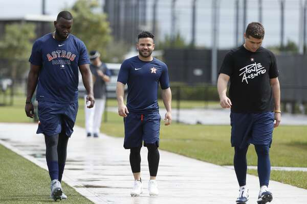 Houston Astros Yordan Alvarez, Jose Altuve and Aledmys Diaz head back to the clubhouse after working out during the Houston Astros spring training workouts at the Fitteam Ballpark of The Palm Beaches, in West Palm Beach , Saturday, Feb. 15, 2020.