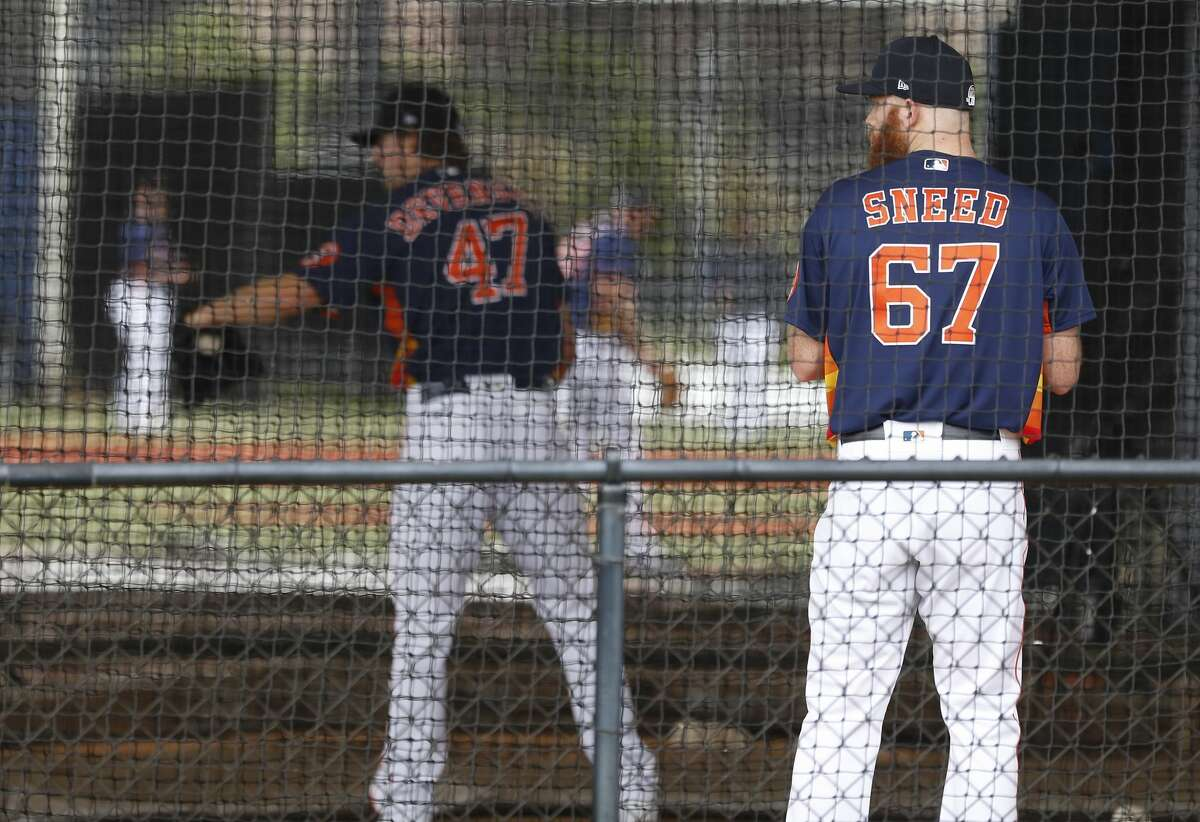 Houston Astros pitchers Cy Sneed (67)and Chris Devenski (47) throw in the batting cages due to rain showers in the area during the Houston Astros spring training workouts at the Fitteam Ballpark of The Palm Beaches, in West Palm Beach , Saturday, Feb. 15, 2020.