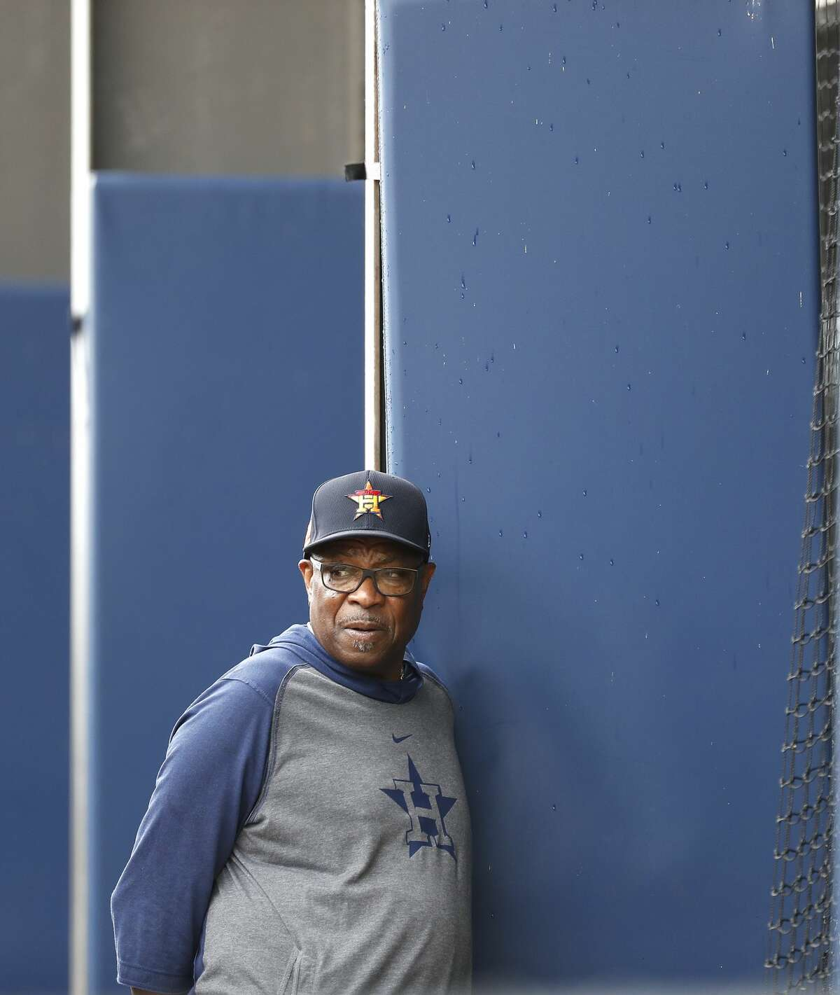 Houston Astros manager Dusty Baker Jr. surveys players working out in the batting cages due to rain showers in the area during the Houston Astros spring training workouts at the Fitteam Ballpark of The Palm Beaches, in West Palm Beach , Saturday, Feb. 15, 2020.