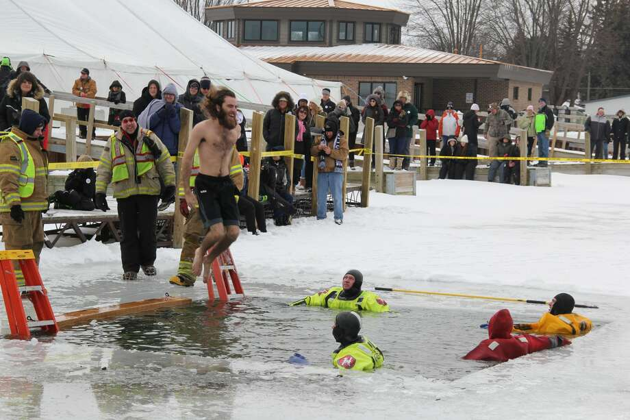 People come from far and wide to have fun at the Caseville Marina for Shanty Days. Aside from the Polar Bear Dip, people ice fished, played broom ball, participated in races, and ate some chili. Photo: Robert Creenan/Huron Daily Tribune