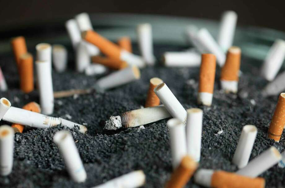 FILE - This March 28, 2019, file photo shows cigarette butts in an ashtray in New York. (AP Photo/Jenny Kane, File) Photo: Jenny Kane / ap