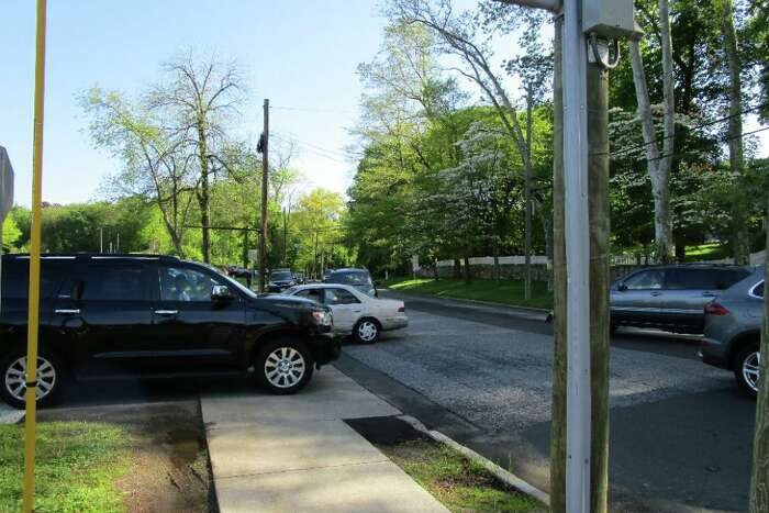 Drivers lining up to go through the pick-up lot at Greenwich High School are seen here blocking traffic for people going south on Hillside Road. The picture was included as part of a traffic report, prepared by Fuss & O'Neill, to see if the Music Instructional Space and Auditorium caused more traffic.