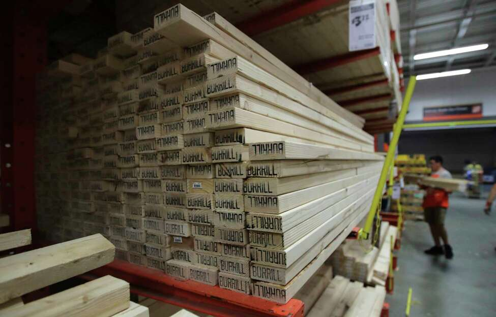FILE - In this July 11, 2019, file photo lumber is stacked at the Home Depot store in Londonderry, N.H. Dona€™t let your desire to upgrade your home downgrade your home's market value. Before you make a renovation fantasy a reality, consider whether the project will pay off when you're ready to sell. (AP Photo/Charles Krupa, File)