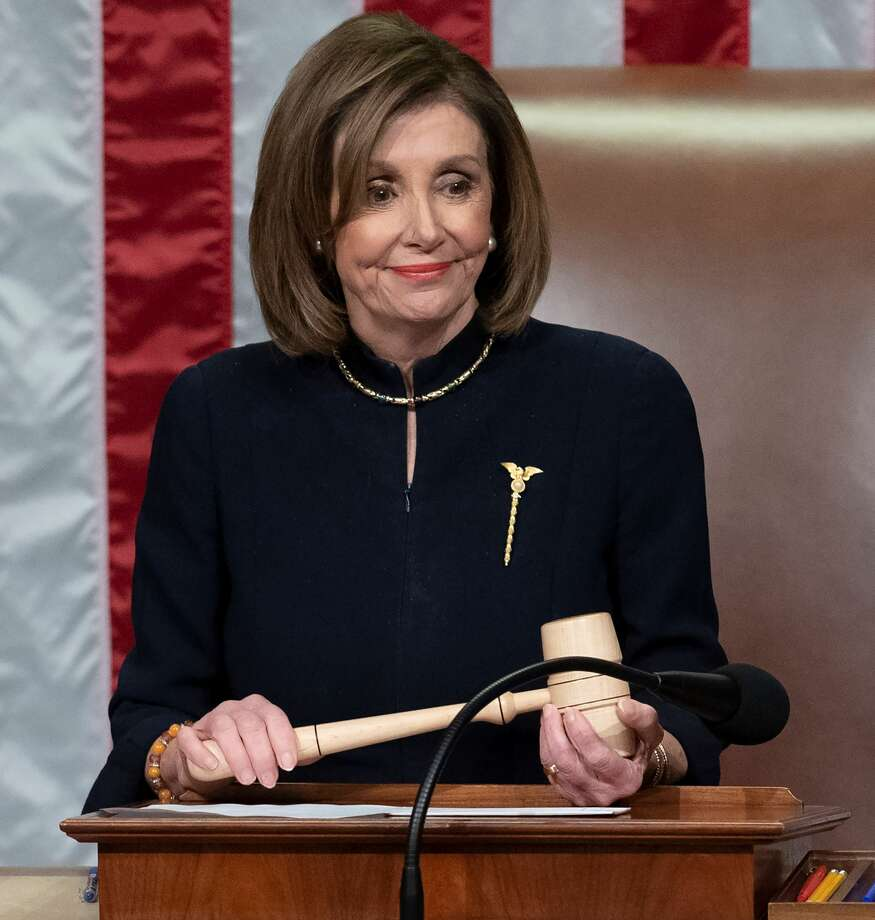 US Speaker of the House Nancy Pelosi presides over Resolution 755, Articles of Impeachment Against President Donald J. Trump as the House votes at the US Capitol in Washington, DC, on December 18, 2019. - The US House of Representatives voted 229-198 on Wednesday to impeach President Donald Trump for obstruction of Congress. The House impeached Trump for abuse of power by a 230-197 vote. The 45th US president is just the third occupant of the White House in US history to be impeached. (Photo by SAUL LOEB / AFP) (Photo by SAUL LOEB/AFP via Getty Images) Photo: SAUL LOEB/AFP Via Getty Images