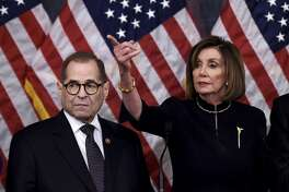 US Speaker of the House Nancy Pelosi (R) and House Judiciary Chairman Jerry Nadler hold a press conference after the House passed Resolution 755, Articles of Impeachment Against President Donald J. Trump, at the US Capitol in Washington, DC, on December 18, 2019. - The US House of Representatives voted 229-198 on Wednesday to impeach President Donald Trump for obstruction of Congress. The House impeached Trump for abuse of power by a 230-197 vote. The 45th US president is just the third occupant of the White House in US history to be impeached. (Photo by Olivier Douliery / AFP) (Photo by OLIVIER DOULIERY/AFP via Getty Images)