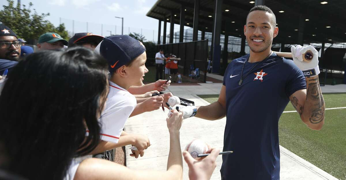 Houston Astros Carlos Correa smiles as he signed autographs for fans during the first day of the Houston Astros pitchers and catchers spring training workout at the Fitteam Ballpark of The Palm Beaches, in West Palm Beach , Thursday, Feb. 13, 2020.