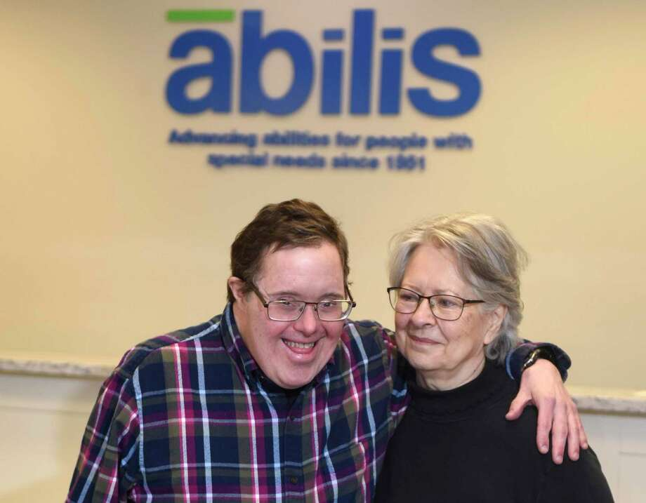 Abilis client Greg Beaurline, 58, and his mother, Theresa Beaurline, 81, pose together at the Abilis headquarters in the Glenville section of Greenwich, Conn. Wednesday, Feb. 5, 2020. Photo: Tyler Sizemore / Hearst Connecticut Media / Greenwich Time