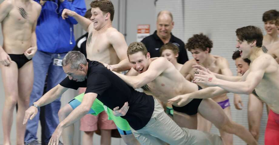 Kingwood Park head coach Greg McLain leads the team as the Panthers celebrate winning the 5A boys state title during the UIL State Swimming & Diving Championships at the Lee & Joe Jamail Texas Swimming Center, Saturday, Feb. 15, 2020, in Austin. Photo: Jason Fochtman/Staff Photographer