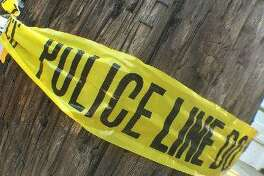 Police tape is seen wrapped around a power pole. File photo