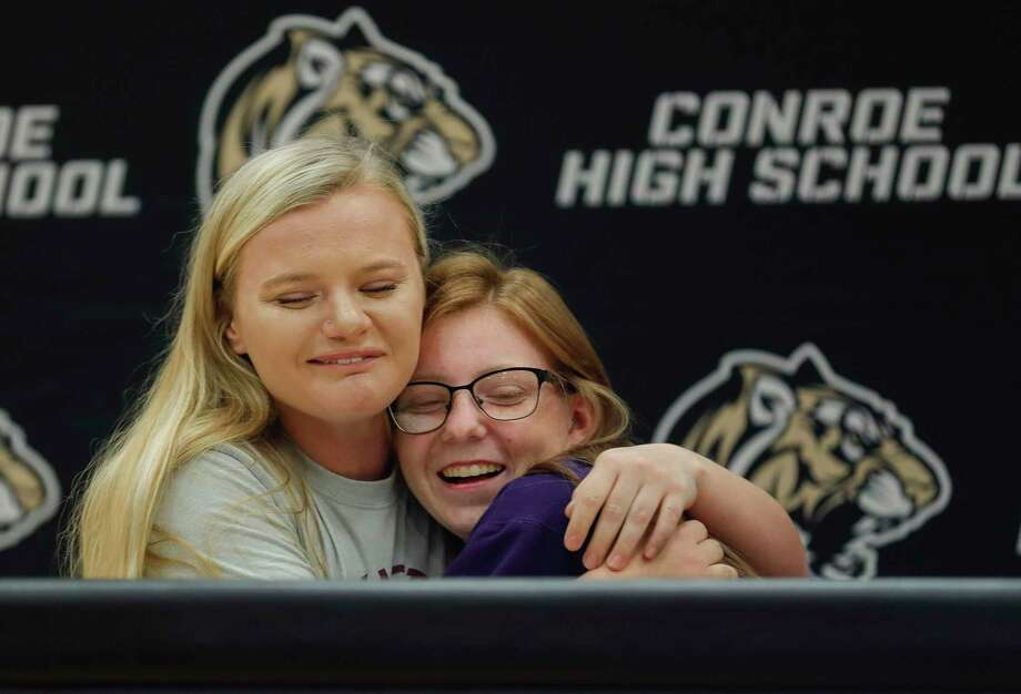 Makenzie Ness, left, hugs Makinsey Exley during a National Signing Day ceremony at Conroe High School, Wednesday, Feb. 5, 2020, in Conroe. Ness signed to play softball for Shawnee Community College, while Exley signed with Southwestern Assemblies of God. Photo: Jason Fochtman, Houston Chronicle / Staff Photographer / Houston Chronicle © 2020