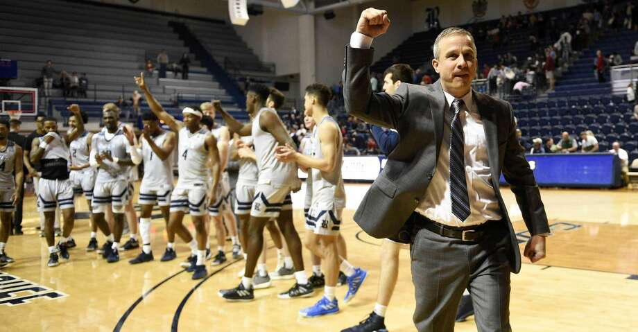 Rice head coach Scott Pera celebrates the team's win over Charlotte after an NCAA college basketball game, Saturday, Feb. 15, 2020, in Houston. Photo: Eric Christian Smith/Contributor