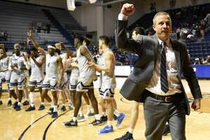 Rice head coach Scott Pera celebrates the team's win over Charlotte after an NCAA college basketball game, Saturday, Feb. 15, 2020, in Houston.