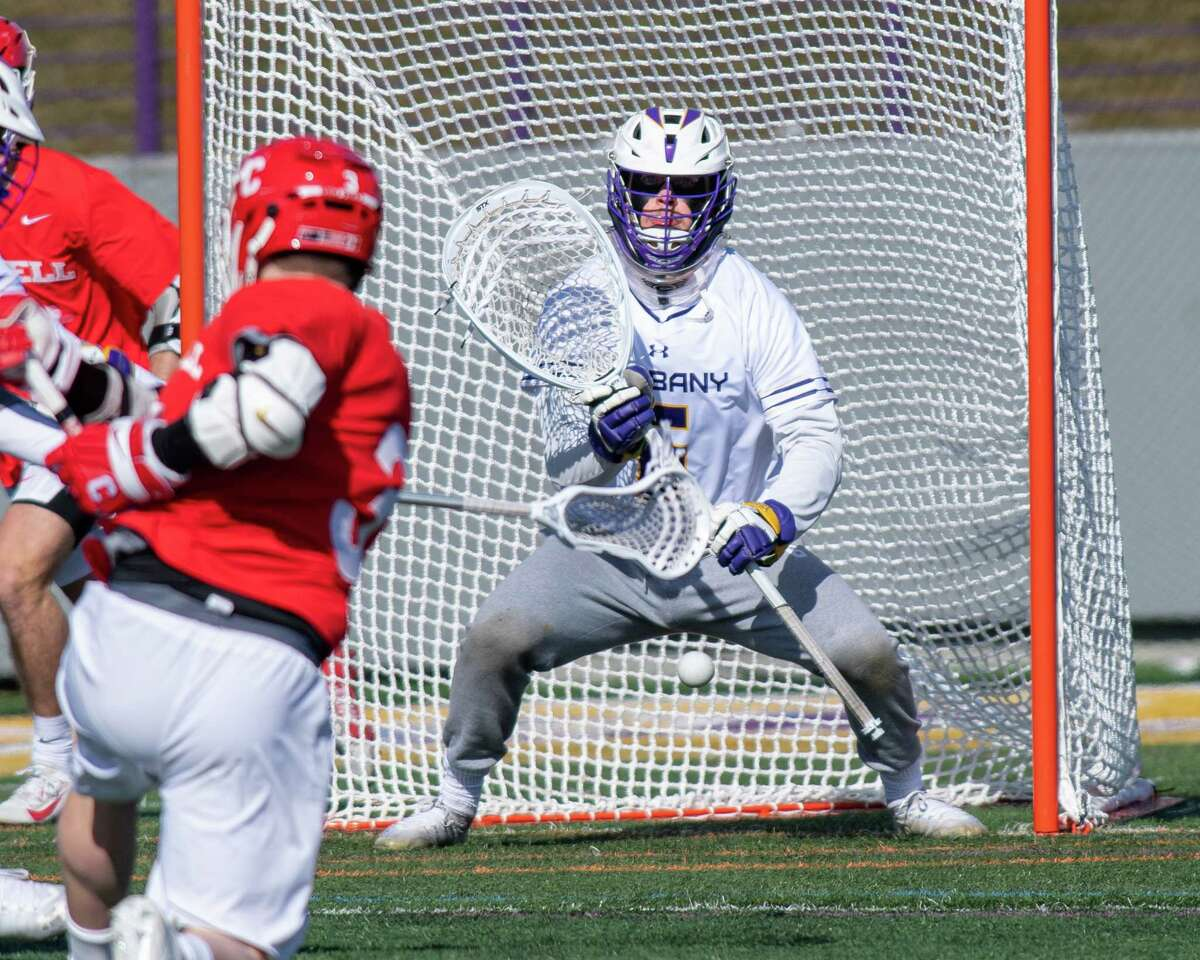 Cornell University junior Jonathan Donville fires a shot at UAlbnay goalie Nate Siekierski during the season opener at UAlbany on Saturday, Feb. 15, 2020 (Jim Franco/Special to the Times Union.)