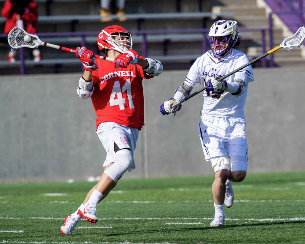 Cornell University junior John Piatelli takes a shot in front of UAlbany sophomore Tanner Hay during the season opener at UAlbany on Saturday, Feb. 15, 2020 (Jim Franco/Special to the Times Union.)