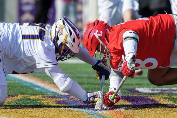 UAlbany junior Anthony Altimari and Cornell University freshman Angelo Petrakis face off during the season opener at UAlbany on Saturday, Feb. 15, 2020 (Jim Franco/Special to the Times Union.)