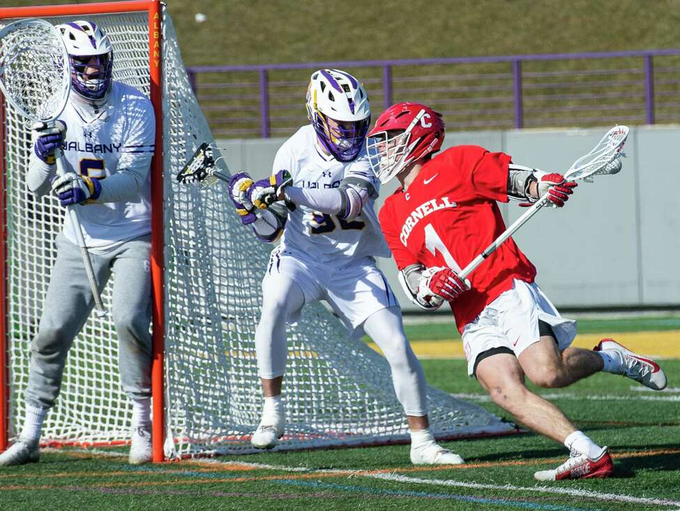 Cornell University freshman Michael Long makes a move towards the goal in front of UAlbany junior Ashton Bradley during the season opener at UAlbany on Saturday, Feb. 15, 2020 (Jim Franco/Special to the Times Union.)
