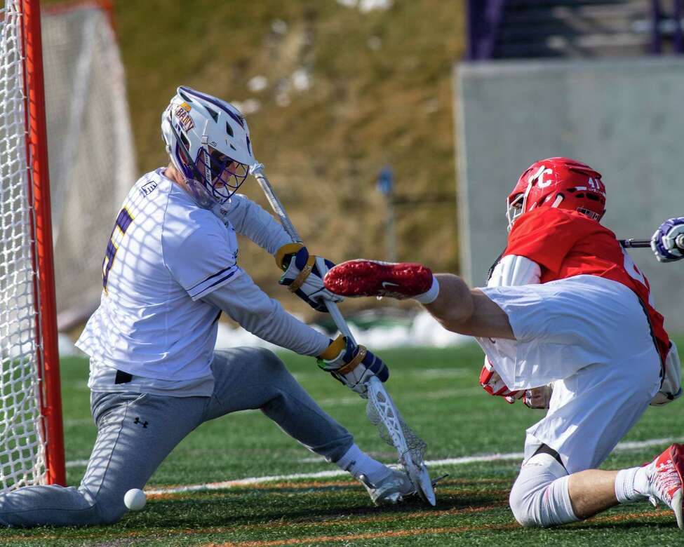 UAlbnay goalie Nate Siekierski blocks a shot by Cornell University junior John Piatelli during the season opener at UAlbany on Saturday, Feb. 15, 2020 (Jim Franco/Special to the Times Union.)