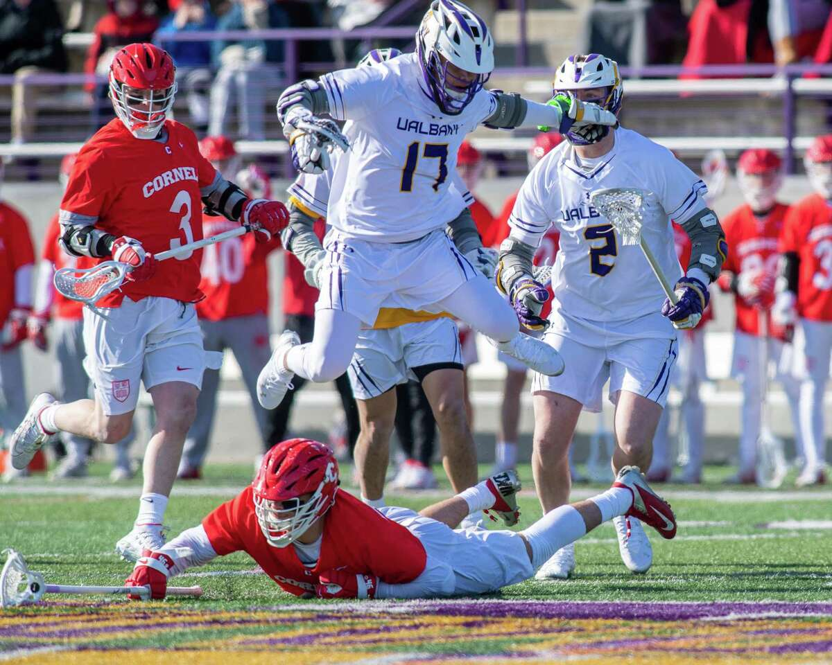 UAlbany senior Jakob Patterson leaps over Cornell University junior Joseph Bartolotto III during the season opener at UAlbany last season. Patterson decided to come back for an extra season when the NCAA said seniors could return for an extra year of eligibility. (Jim Franco/Times Union archive)