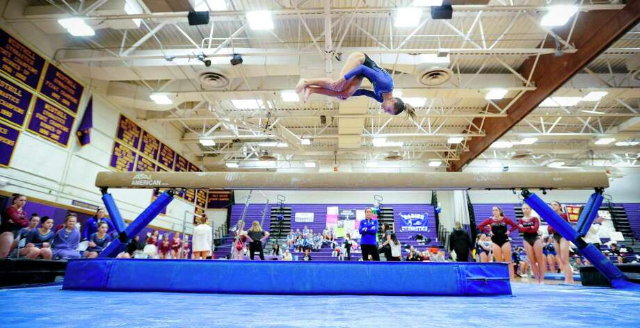 Fairfield Ludlowe's Ava Mancini competes on the beam during the FCIAC championships on Saturday. Ludlowe won the team title and Mancini took top individual honors. Photo: Matthew Brown / Hearst Connecticut Media / Stamford Advocate