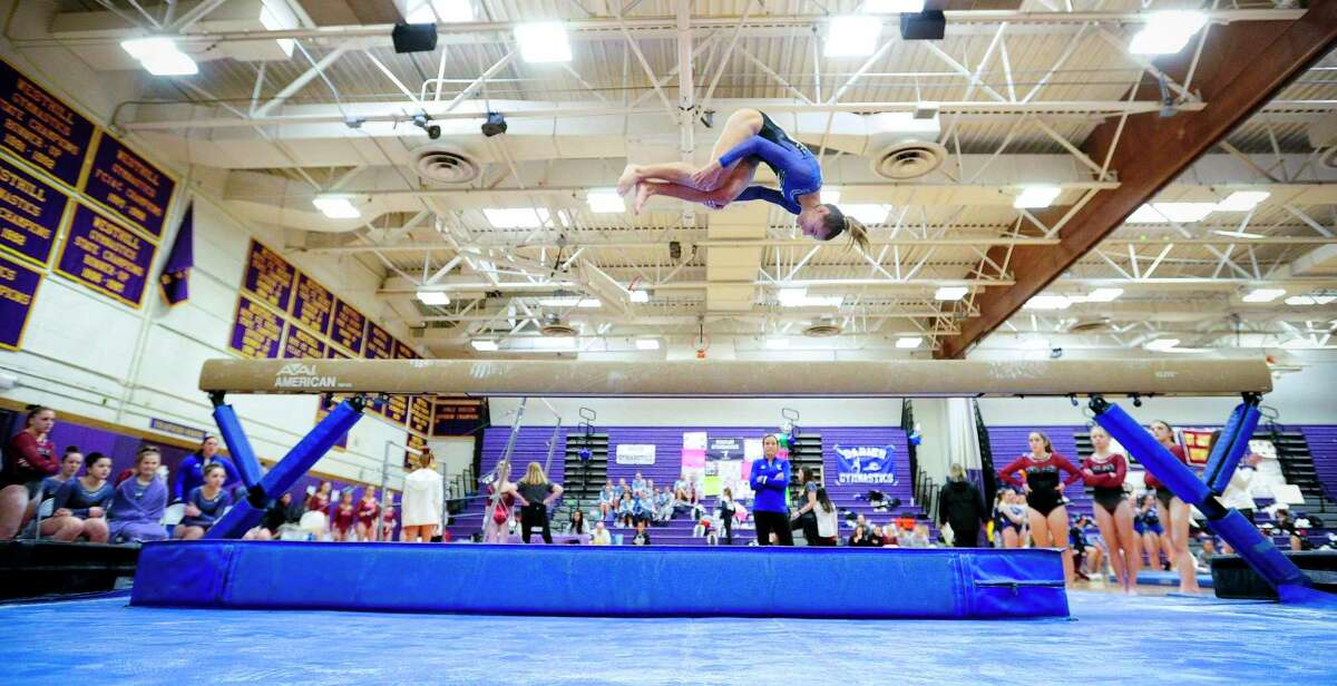 Fairfield Ludlowe's Ava Mancini competes on the beam during the FCIAC championships on Saturday. Ludlowe won the team title and Mancini took top individual honors.