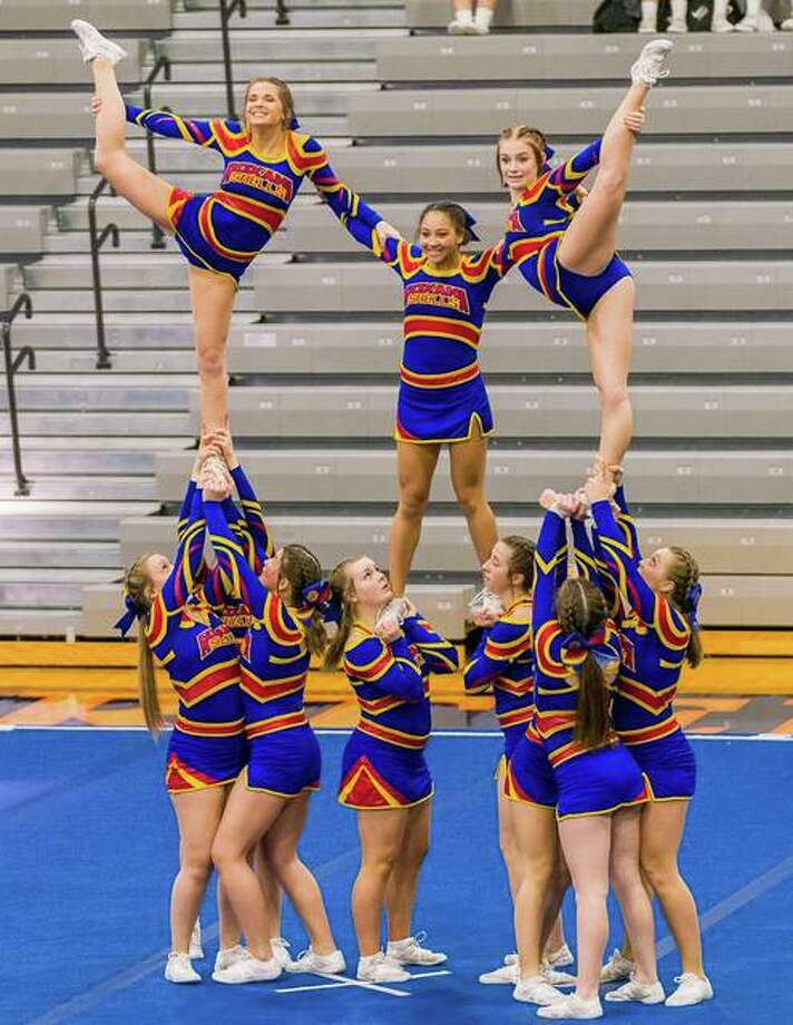 Roxana Senior High's varsity cheerleading team practices for the Illinois High School Association state competition, in which the team captured sixth place earlier this month. The squad is made up of Taylor Baalman, Jada Covington, Payton Hartman, Jayln Hoormann, Kortni Laws, Piper Martin, Paige Matheny, Anna McLain, Valerie Nyswonger, Emily Ogle, Sydnee Simms, Kaylee Ward and Hannah White. Photo: Photo Credit Marty Nyswonger|For The Telegraph