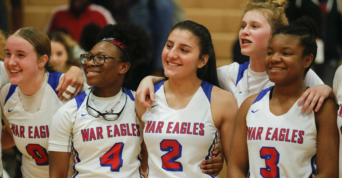 Oak Ridge players Grace Roberts (0), point guard Malade Hollis (4), shooting guard Alyssa Castro (2), point guard Nicole Petrakovitz (1) and point guard Logan Fuller (3) are seen after defeating Conroe 62-52 to win the District 15-6A title at Oak Ridge High School, Tuesday, Feb. 11, 2020, in Oak Ridge.