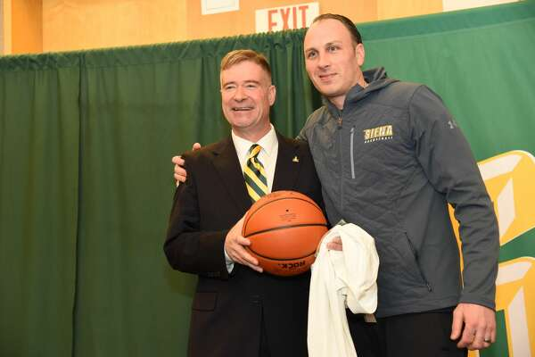 New Siena president Chris Gibson, left, poses with men's basketball coach Carmen Maciariello at a news conference on Feb. 14, 2020. (Siena College)