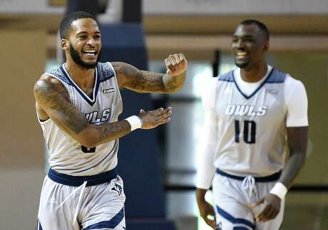 Rice guard Ako Adams, left, celebrates a basket during the first half of Saturday's game against Charlotte.