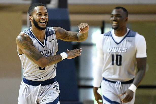 Rice guard Ako Adams, left, celebrates a basket during the first half of an NCAA college basketball game against Charlotte, Saturday, Feb. 15, 2020, in Houston.