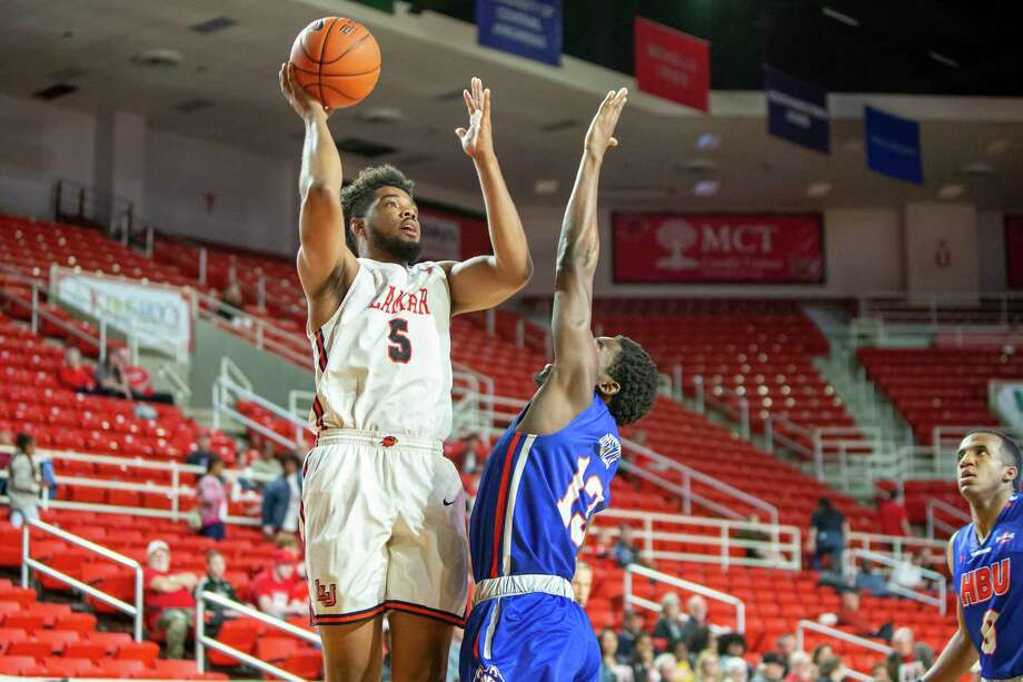 Lamar's Avery Sullivan rises up for a shot over an HBU defender during a win for the Cardinals on Saturday afternoon. Photo provided by Lamar athletics. Photo: By Jarrod Brown / Jarrod Brown / Jarrod Brown