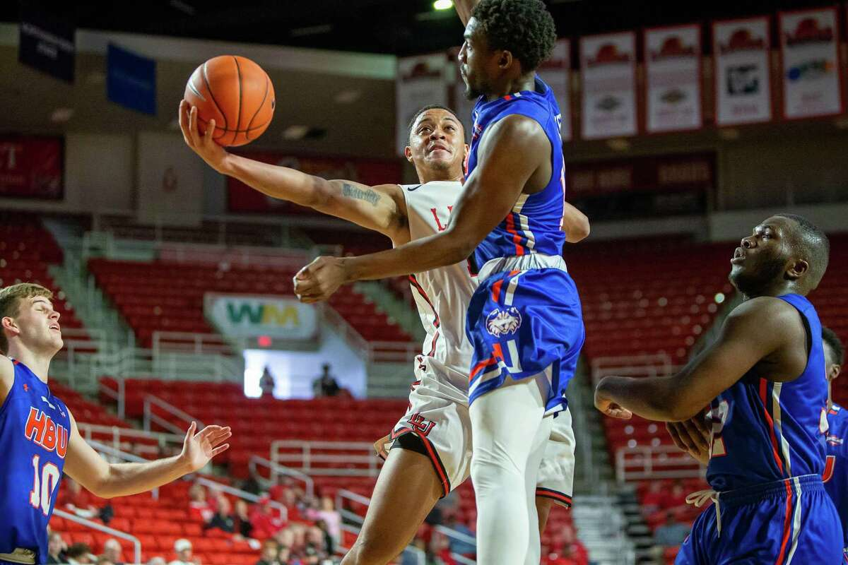 Lamar's T.J. Atwood drives through the lane during a win for the Cardinals over HBU on Saturday at the Montagne Center.