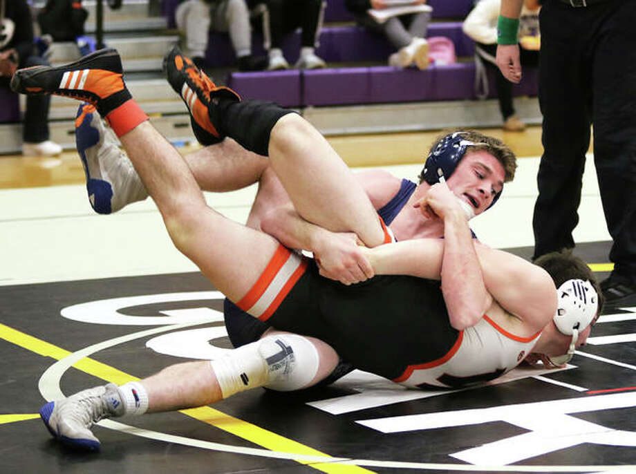 Jersey's Zeke Waltz (top) tries to turn Waterloo's Brandon Lloyd in the 160-pound championship match Saturday at the Mascoutah Class 2A Sectional. Waltz won a 6-0 decision to improve to 40-0.